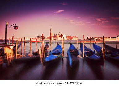 Gondolas float on sea in Venice, Italy
