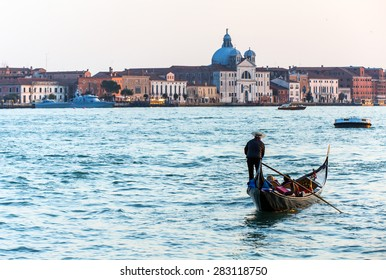 Gondolas floating on canal , venice italy