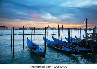 Gondolas in the grand canal at sunset, Venice, Italy