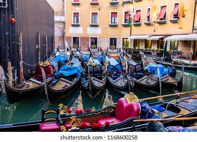 gondolas in Grande Canal in Venice, Italy, Colorful gondola in waterfront. Venice, Italy