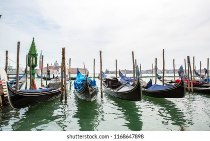 Gondolas in Grande Canal in Venice, Italy, Colorful gondola in waterfront. Venice, Italy