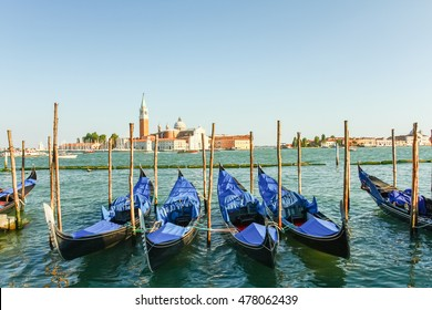 Gondolas moored by Saint Mark square with San Giorgio di Maggiore church in the background, Venice, Italy