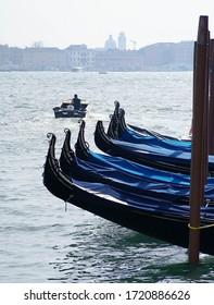 Gondolas moored in the lagune of Venice Italy