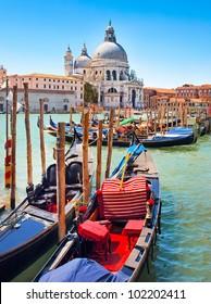 Gondolas on Canal Grande with Basilica di Santa Maria della Salute in the background in Venice, Italy