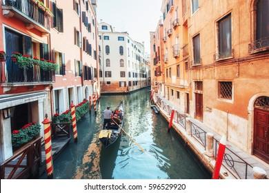 Gondolas on canal in Venice. Venice is a popular tourist destination of Europe