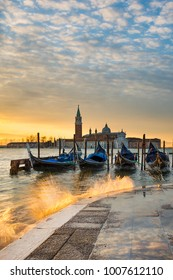 Gondolas on the Grand Canal at sunrise in Venice, Italy