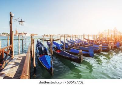Gondolas on Grand canal in Venice, San Giorgio Maggiore church. San Marco. Beautiful summer landscape