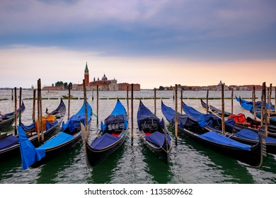 Gondolas on a pier at Traghetto Gondole Molo, Venice, Italy. Popular Europe travel destination. Most common photo