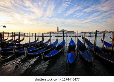 Gondolas at sunrise near Piazza San Marco