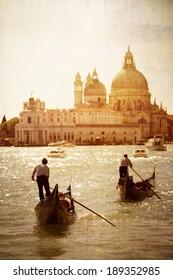 Gondolas and sunset in front of Santa Maria Della Salute, Venice, Italy in old-fashioned dreamy style