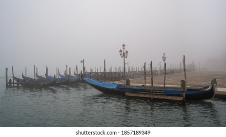 Gondolas in Venice in the morning fog without touristis