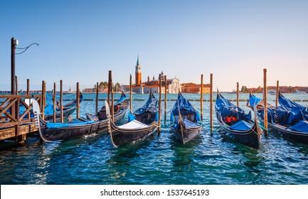 Gondolas in Venice, near St. Mark's Square, in the distance the Church of San Giorgio Maggiore