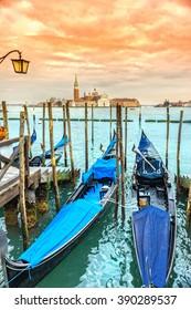 Gondolas in Venice - with San Giorgio Maggiore church. San Marco, Venice, Italy