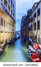 Gondolas in Venice at sunrise. Venice, Veneto, Italy.