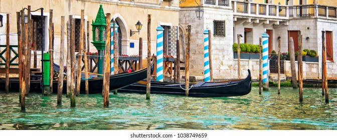 Gondolas and wooden piles on the grand Canal, panorama of Venice, Italy