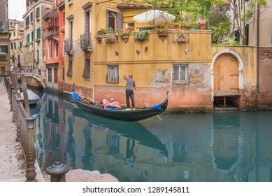 gondolier and Canal in Venice