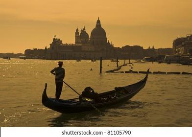 Gondolier at the dusk in Venice, Italy