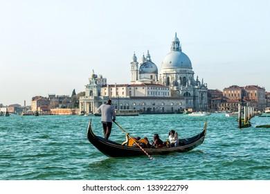 A gondolier on the Grand canal against Basilica di Santa Maria della Salute
