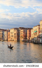 A gondoliere on canal grande seen from Rialto bridge in Venice at dusk
