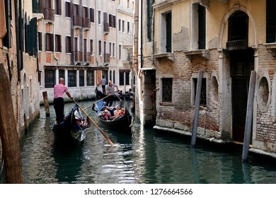 Gondoliers carry tourists through the narrow streets of the city Venice, Italy 25.09.2017