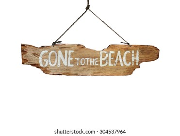 Gone to the Beach hand carved sign - holiday vacation concept image.