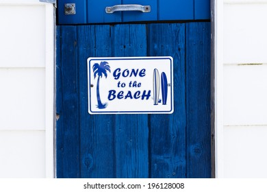 Gone to the Beach Sign on a Blue Painted Wood Door