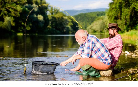Gone Fishing. big game fishing. relax on nature. Two male friends fishing together. fly fish hobby of men. retirement fishery. happy fishermen friendship. retired father and mature bearded son.