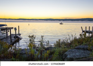 Gone Fishing. Recreational boat on Lake Superior at sunrise going salmon fishing in an Upper Peninsula bay.