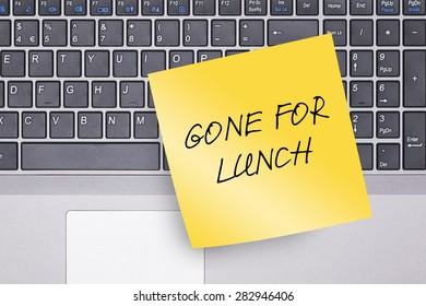 Gone for Lunch Note on Keyboard Concept Photo