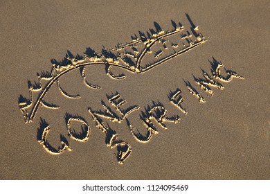Gone surfing and wave drawn in the sand. Summer beach concept