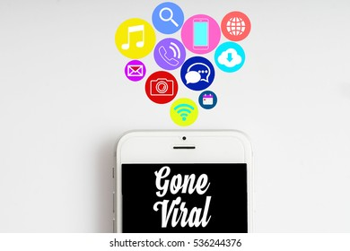 """Gone Viral"" words on smartphone with social media icon with white background - business, finance and copy space concept"