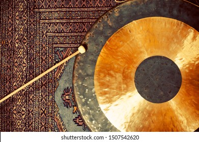 Gong resting on an asian oriental traditional rug.