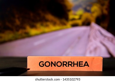 Gonorrhea on the sticky notes with bokeh background