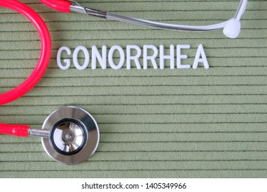 Gonorrhea - text from white letters on a green background with a stethoscope, medical concept diagnostics, treatment, healthcare.