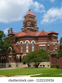 Gonzales County Texas Courthouse bulit in a Romanesque Revival style with bricks from St. Louis Missouri