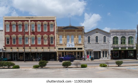 GONZALES, TEXAS - JUNE 10 2018: the Masonic Building dated 1891 and 3 others showing very different architecture
