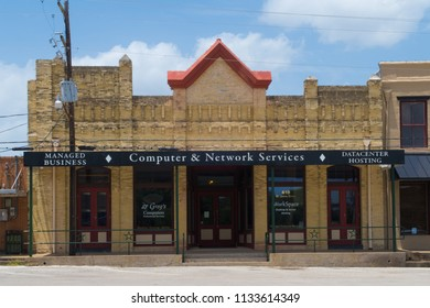 GONZALES, TEXAS - JUNE 10 2018: old meets the new on the square in a small Texas town with a large history