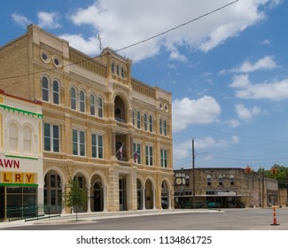 GONZALES, TEXAS - JUNE 10 2018: three very different styles of architecture on the same block