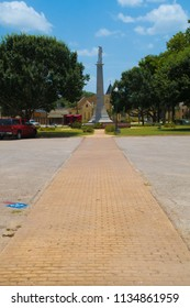 GONZALES, TEXAS - JUNE 10 2018: a coblestone walkway leading to a confederate monument