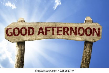Good Afternoon wooden sign on a beautiful day