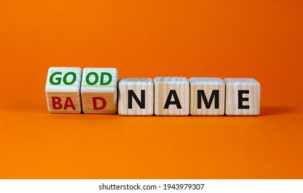 Good or bad name symbol. Turned wooden cubes and changed words 'bad name' to 'good name'. Beautiful orange background, copy space. Business and good or bad name concept.