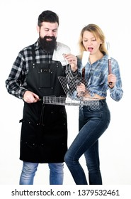Good for barbecue. Bearded man and pretty woman holding grilling grate. Happy couple having grill grid for grilling. Grilling is a healthy way of cooking food. Family gathering with grilling mangal.