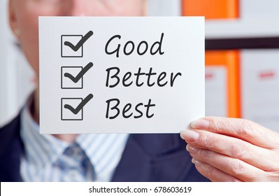 Good, Better, Best - Excellent Performance and Service - Manager with sign and checklist in the office