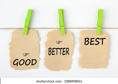 GOOD BETTER BEST writen on old torn paper with clip hanging on white background.