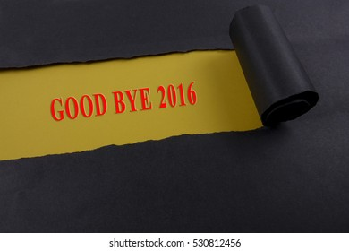 Good bye 2016 on black torn paper.