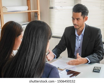 Good calm boss complains mistake employees politely and reasonably.