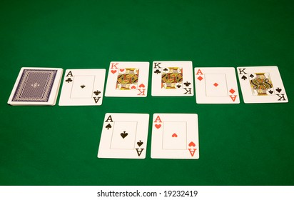 Good card on winning hand in poker at casino on green table