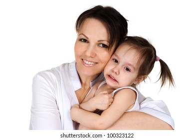 Good Caucasian nurse holding a baby girl on a white background