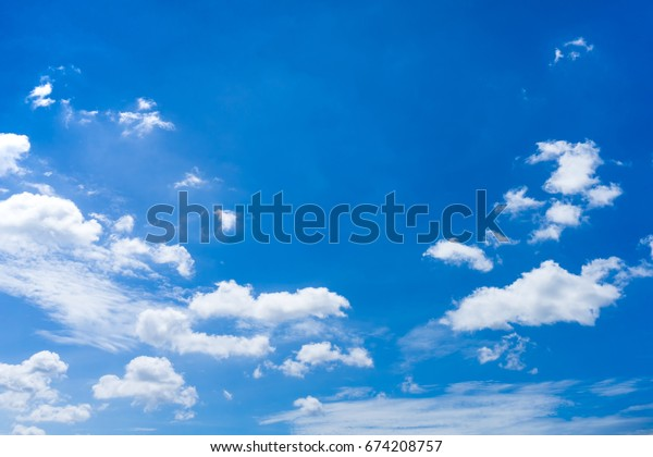 good day nice weather blue sky and some cumulus clouds on it