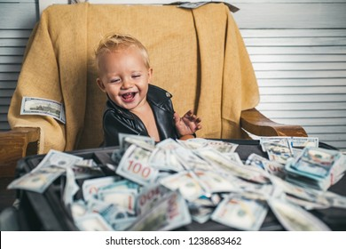 Good deal. Small child do business accounting in startup company. Little entrepreneur work in office. Boy child with money case. Little boy count money in cash. Startup business costs.